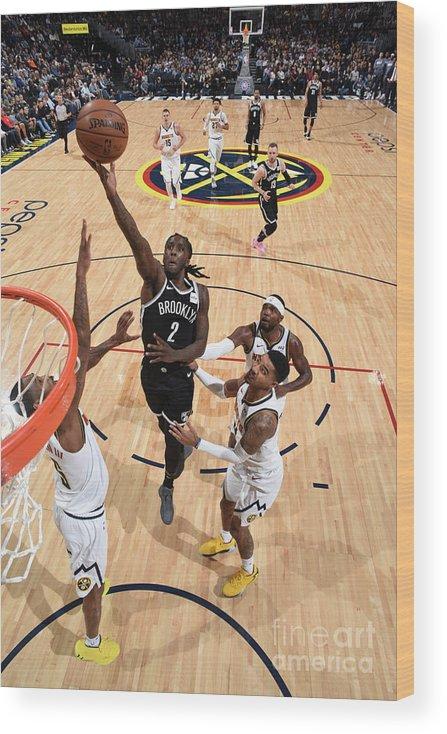 Nba Pro Basketball Wood Print featuring the photograph Brooklyn Nets V Denver Nuggets by Garrett Ellwood