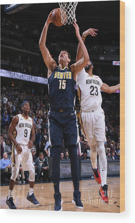 Nba Pro Basketball Wood Print featuring the photograph New Orleans Pelicans V Denver Nuggets by Garrett Ellwood
