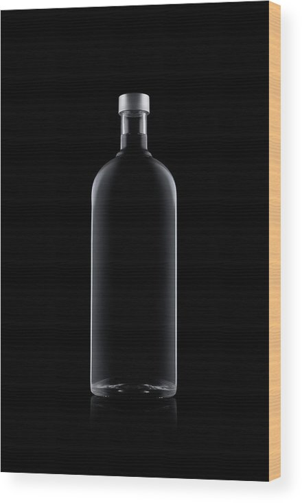 Black Color Wood Print featuring the photograph Bottle Of Water Isolated On Black by Kedsanee