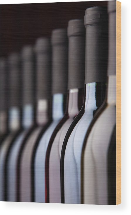 Alcohol Wood Print featuring the photograph Bottles Of Wine In A Row by Halbergman