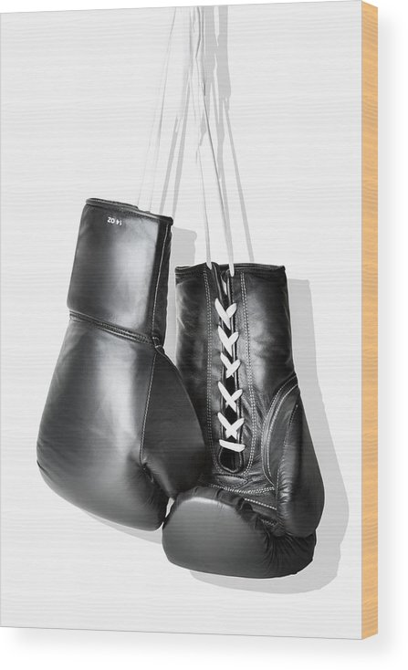 Hanging Wood Print featuring the photograph Boxing Gloves Hanging Against White by Burazin