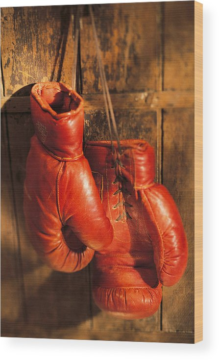 Hanging Wood Print featuring the photograph Boxing Gloves Hanging On Rustic Wooden by Comstock