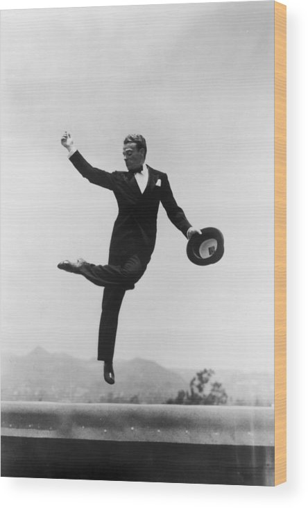 Wind Wood Print featuring the photograph Cagney Leaping In Formal Attire by Getty Images