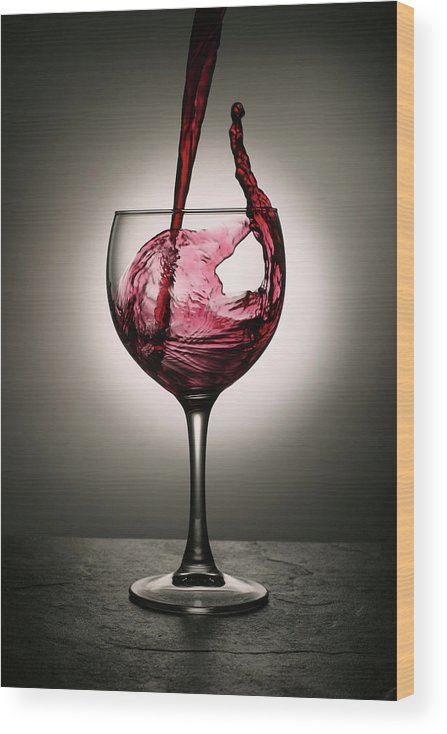 Alcohol Wood Print featuring the photograph Dramatic Red Wine Splash Into Wine Glass by Donald gruener