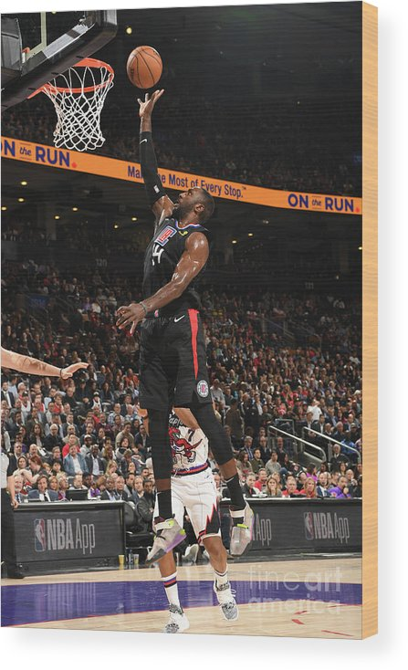 Patrick Patterson Wood Print featuring the photograph La Clippers V Toronto Raptors by Ron Turenne