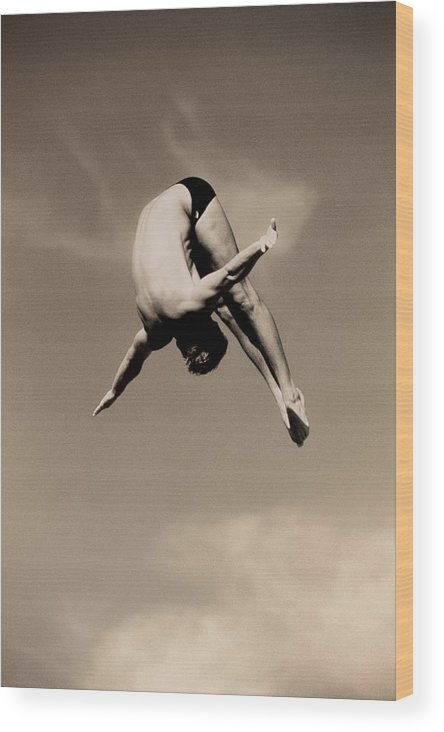 Diving Into Water Wood Print featuring the photograph Male Diver In Mid-air by David Madison