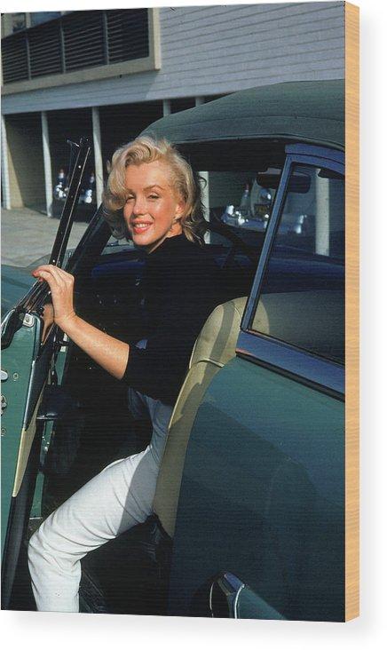 Marilyn Monroe Wood Print featuring the photograph Marilyn Monroe Getting Out Of A Car by Alfred Eisenstaedt