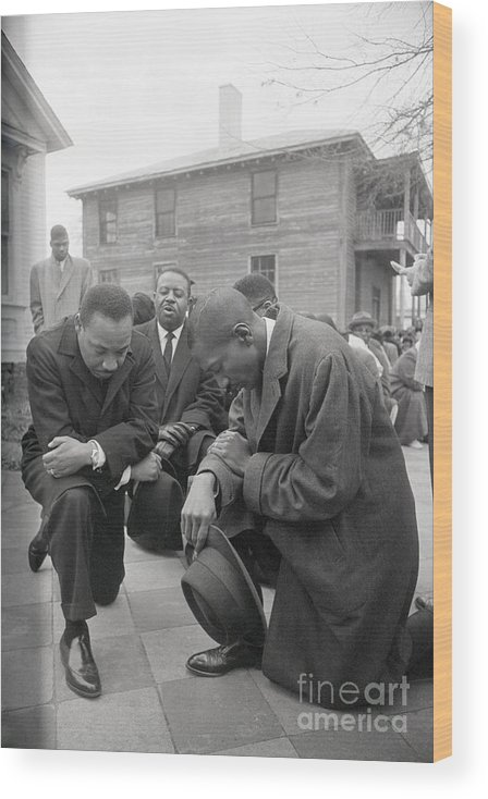 Mature Adult Wood Print featuring the photograph Martin Luther King Jr. Praying by Bettmann