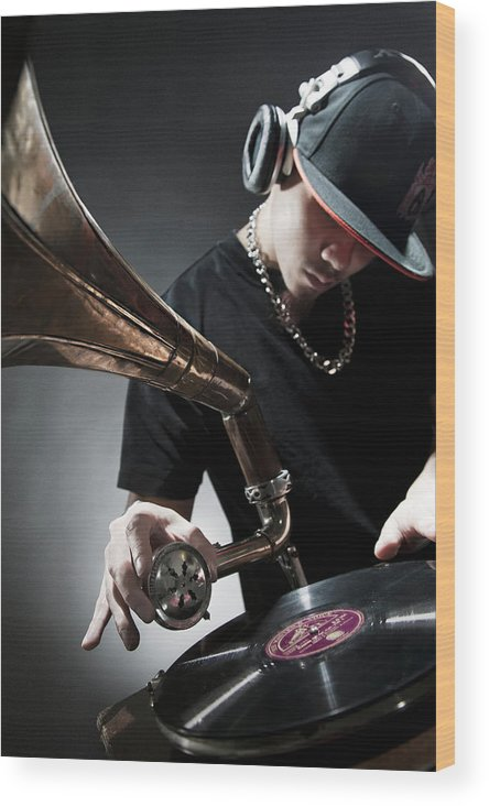 Youth Culture Wood Print featuring the photograph Oriental Dj Using Old Gramophone To Mix by Justin Lambert
