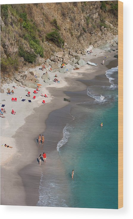 Water's Edge Wood Print featuring the photograph People Relax On Shell Beach by Holger Leue