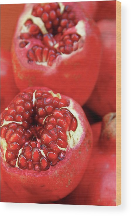 Fermenting Wood Print featuring the photograph Pomegranates by Oonal