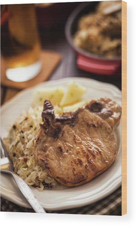 Meat Chop Wood Print featuring the photograph Pork Chop And Sauerkraut by Gmvozd