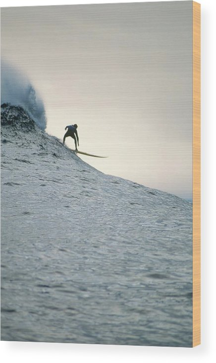 Scenics Wood Print featuring the photograph Silhouette Of A Surfer Riding A Wave by Dominic Barnardt