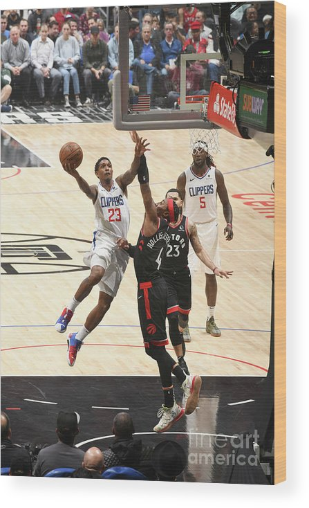 Nba Pro Basketball Wood Print featuring the photograph Toronto Raptors V Los Angeles Clippers by Adam Pantozzi