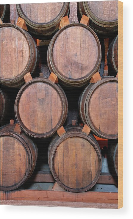 Fermenting Wood Print featuring the photograph Wine Barrels Stacked Inside Winery by Yinyang
