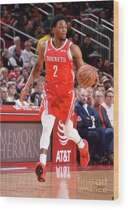 Nba Pro Basketball Wood Print featuring the photograph Brandon Knight by Bill Baptist