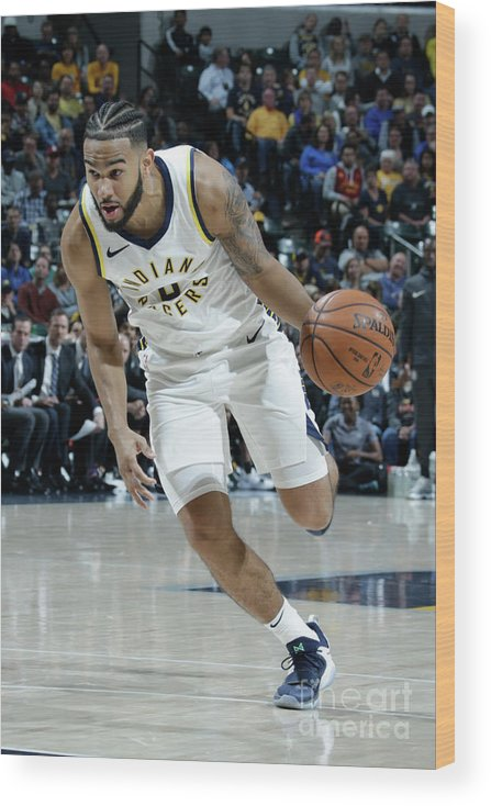 Nba Pro Basketball Wood Print featuring the photograph Cory Joseph by Ron Hoskins