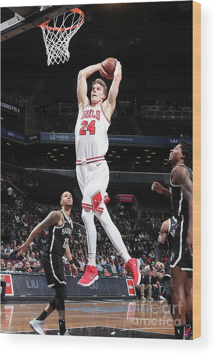 Chicago Bulls Wood Print featuring the photograph Lauri Markkanen by Nathaniel S. Butler