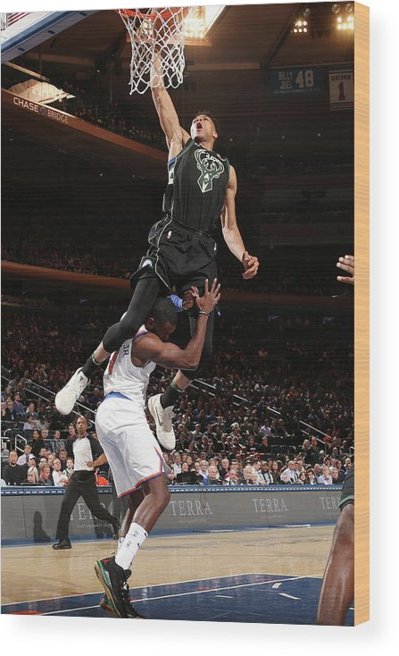 Tim Hardaway Jr. Wood Print featuring the photograph Giannis Antetokounmpo by Ned Dishman