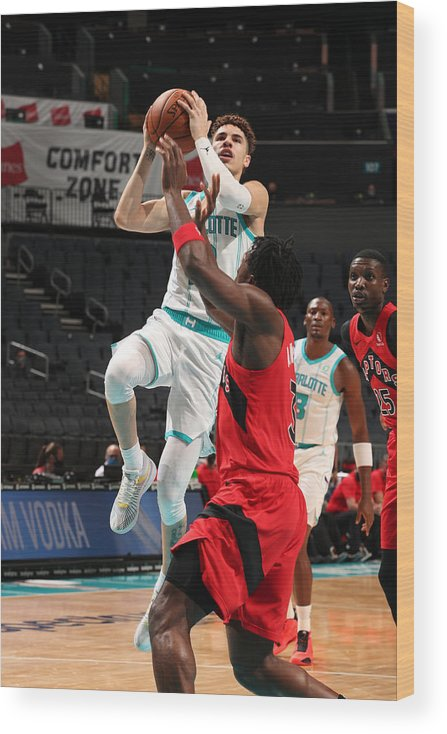 Nba Pro Basketball Wood Print featuring the photograph Toronto Raptors v Charlotte Hornets by Kent Smith