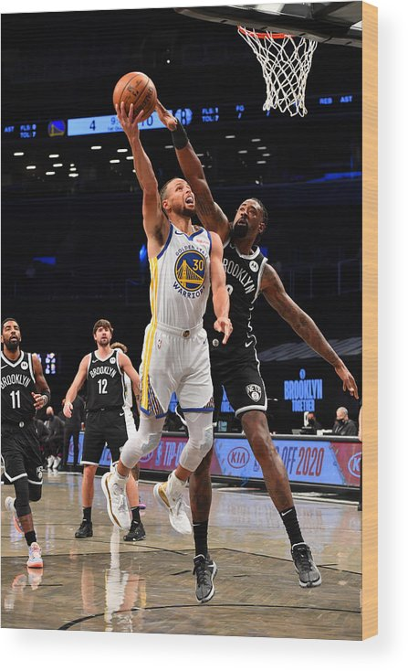 Nba Pro Basketball Wood Print featuring the photograph Stephen Curry by Jesse D. Garrabrant