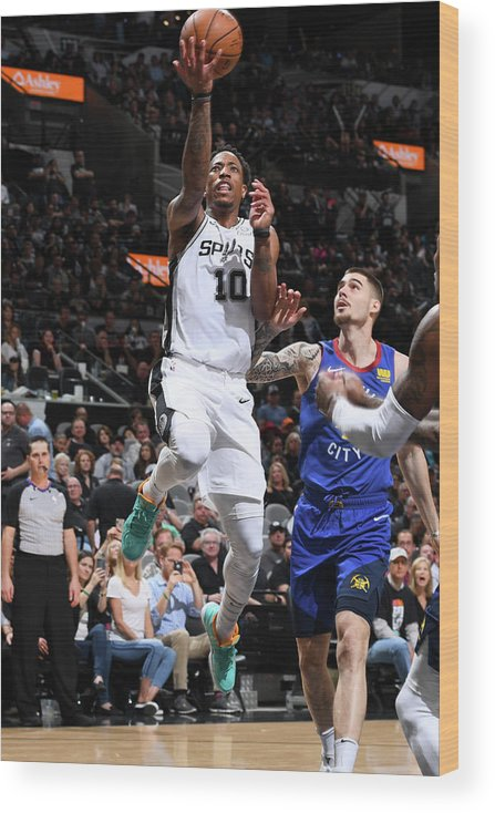 Playoffs Wood Print featuring the photograph Demar Derozan by Garrett Ellwood