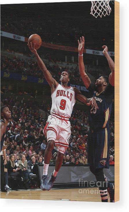 Nba Pro Basketball Wood Print featuring the photograph Rajon Rondo by Gary Dineen