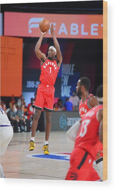 Nba Pro Basketball Wood Print featuring the photograph Toronto Raptors v Phoenix Suns by Bill Baptist