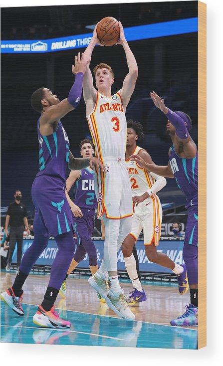 Nba Pro Basketball Wood Print featuring the photograph Atlanta Hawks v Charlotte Hornets by Brock Williams-Smith