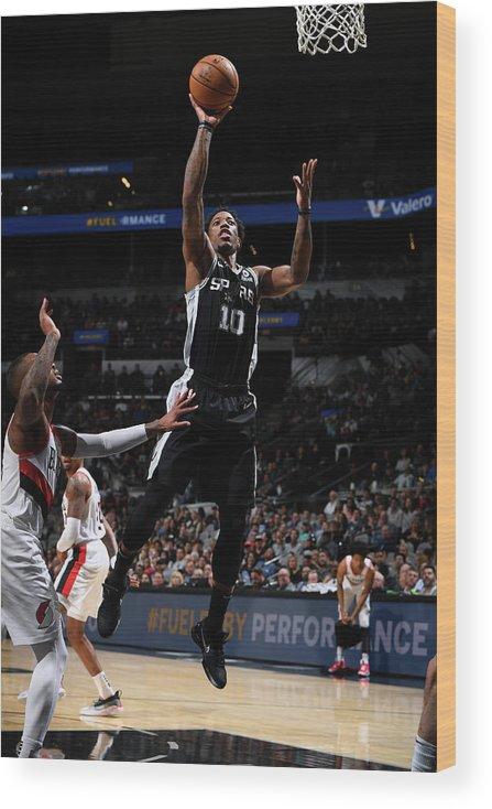 Nba Pro Basketball Wood Print featuring the photograph Demar Derozan by Garrett Ellwood