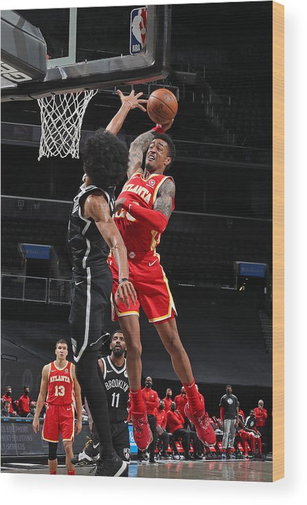 Nba Pro Basketball Wood Print featuring the photograph John Collins by Nathaniel S. Butler