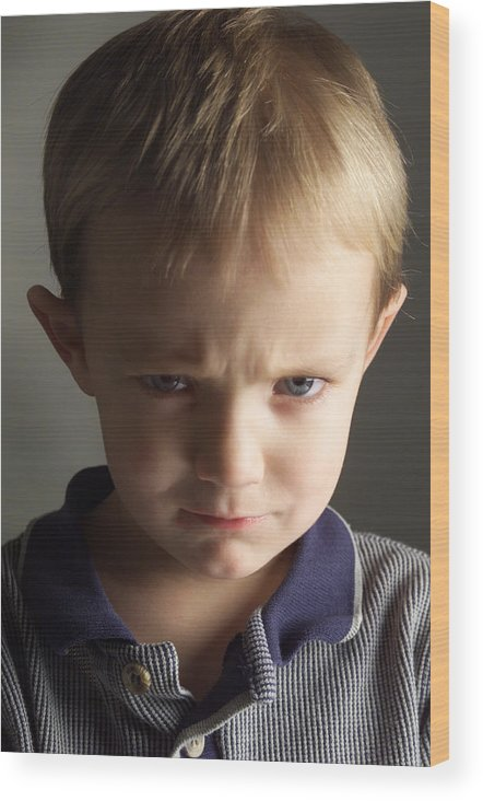 Toddler Wood Print featuring the photograph A Cute Little Caucasian Boy With Light Brown Hair Is Wearing A Stripped Blue Shirt And Pouting by Photodisc