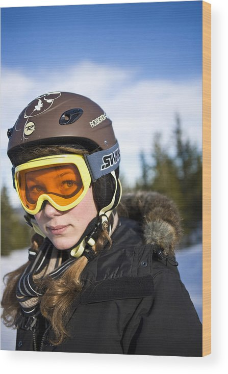 Crash Helmet Wood Print featuring the photograph A girl wearing ski goggles Sweden. by Ulf Huett Nilsson
