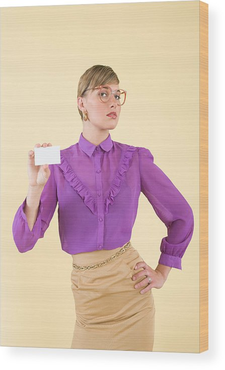 People Wood Print featuring the photograph A woman holding a business card by Image Source