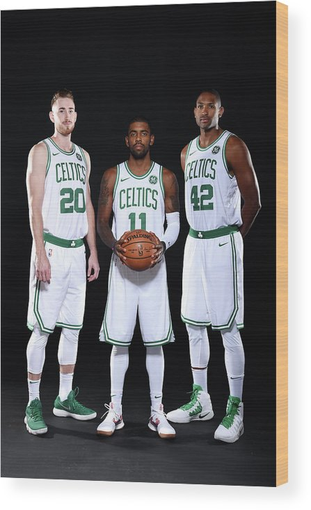 Media Day Wood Print featuring the photograph Al Horford, Kyrie Irving, and Gordon Hayward by Brian Babineau