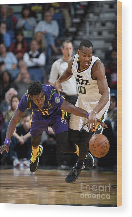 Smoothie King Center Wood Print featuring the photograph Alec Burks and Jrue Holiday by Garrett Ellwood