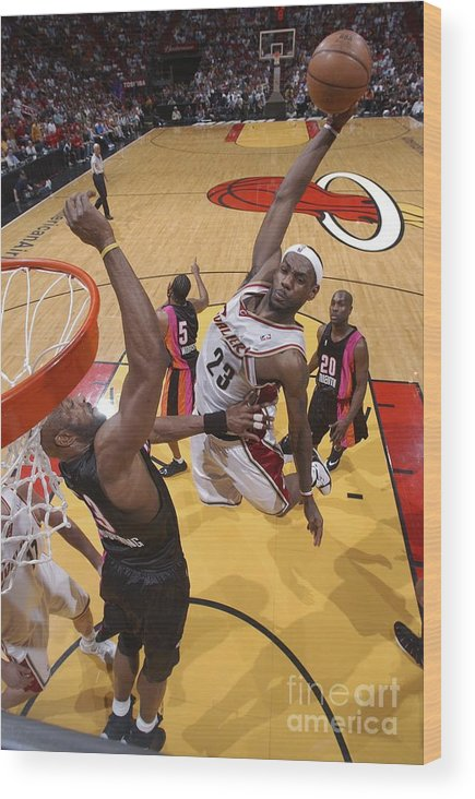 Nba Pro Basketball Wood Print featuring the photograph Alonzo Mourning and Lebron James by Andrew D. Bernstein