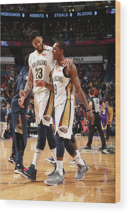 Smoothie King Center Wood Print featuring the photograph Anthony Davis and Rajon Rondo by Layne Murdoch
