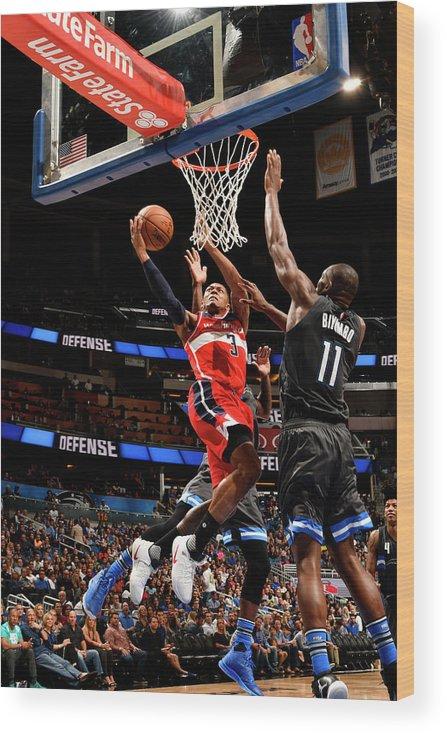 Nba Pro Basketball Wood Print featuring the photograph Bismack Biyombo and Bradley Beal by Fernando Medina