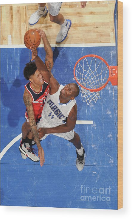 Nba Pro Basketball Wood Print featuring the photograph Bismack Biyombo and Kelly Oubre by Fernando Medina
