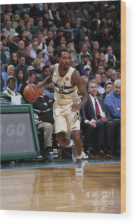 Nba Pro Basketball Wood Print featuring the photograph Brandon Jennings by Gary Dineen