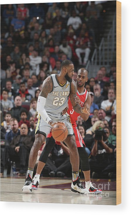Nba Pro Basketball Wood Print featuring the photograph Chris Paul and Lebron James by Joe Murphy