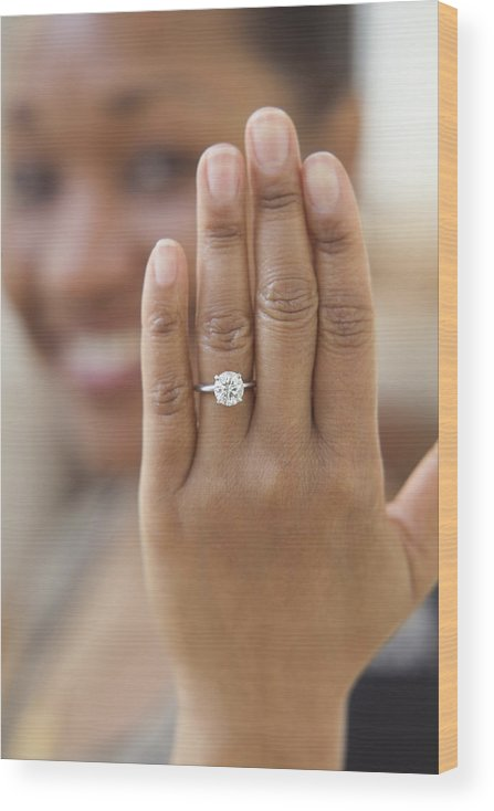 40-44 Years Wood Print featuring the photograph Close up of hand with engagement ring by Jose Luis Pelaez Inc
