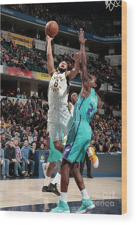 Nba Pro Basketball Wood Print featuring the photograph Cory Joseph by Ron Hoskins