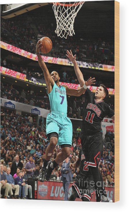 Nba Pro Basketball Wood Print featuring the photograph Doug Mcdermott and Ramon Sessions by Kent Smith