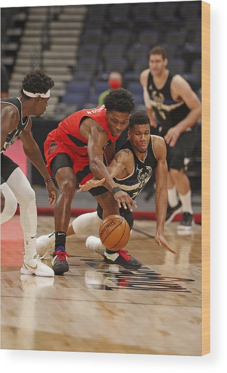 Nba Pro Basketball Wood Print featuring the photograph Giannis Antetokounmpo and Stanley Johnson by Scott Audette