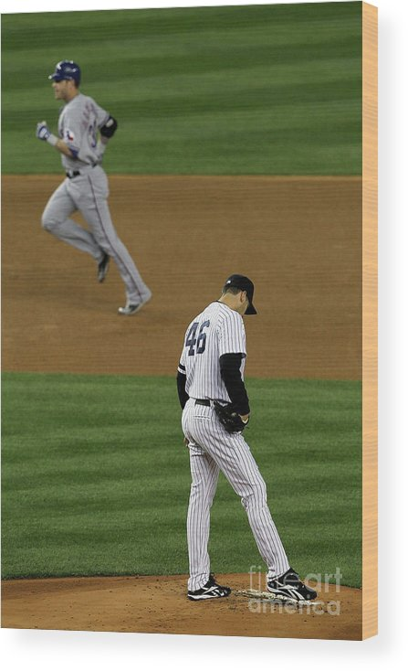 Playoffs Wood Print featuring the photograph Josh Hamilton and Andy Pettitte by Jim Mcisaac