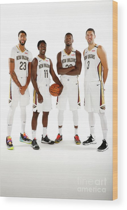 Media Day Wood Print featuring the photograph Jrue Holiday, Anthony Davis, and Julius Randle by Jonathan Bachman