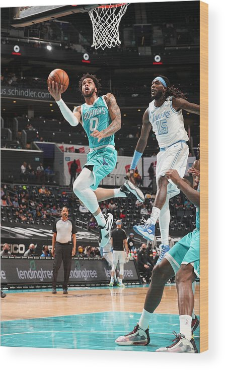 Nba Pro Basketball Wood Print featuring the photograph Los Angeles Lakers v Charlotte Hornets by Kent Smith