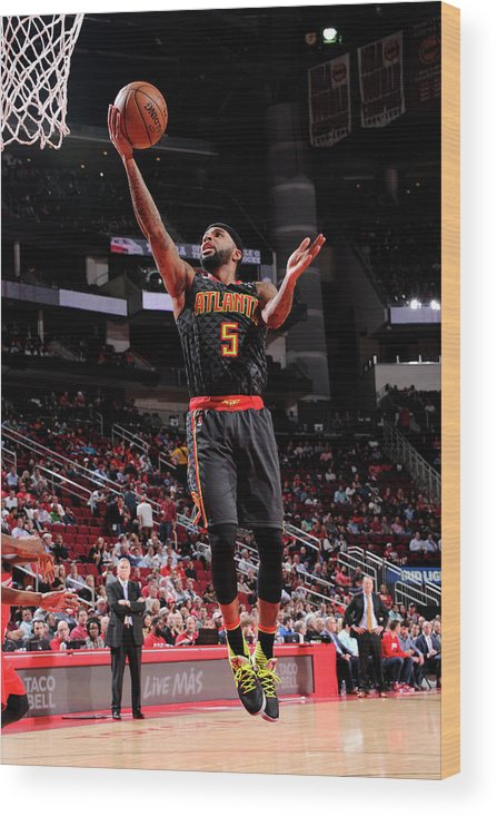 Nba Pro Basketball Wood Print featuring the photograph Malcolm Delaney by Bill Baptist